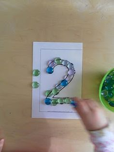 Making numbers by filling it in with stone gems
