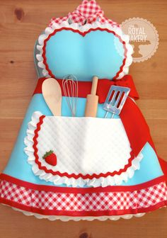 Apron Kitchen Tea Bridal Shower Cake - A 'kitchen tea' bridal shower cake with a retro apron theme. The utensils are real - a keepsake for the bride. The gingham is an edible image.  The apron design is a replica of a real apron by Dotty's Diner on Etsy.