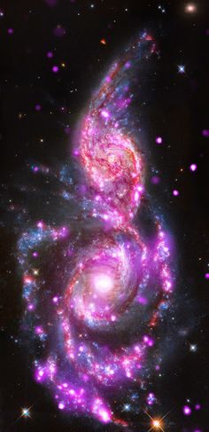 Merging Galaxies Bursting With Light - NGC 2207 and IC 2163