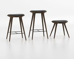 Design by Space, Denmark.  This sturdy and stylish stool is made of stained North American white oak or in recycled aluminum both with black leather seat . The wood supplier is approved by the Forest Stewardship Coundil (FSC). All stools are crafted in a workshop participating in SUSBIZ, an initiative for the promotion of sustainable business practices in India which provides assistance to local native crafts people.