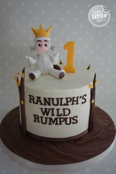 Where The Wild Things Are themed birthday cake. A cute King Max on top, vanilla buttercream frosting on the outside with simple tree fondant decorations. Fondant lettering a little wonky on the front but hey, it was a hot day in the HLB kitchen! I based the design on some cute WTWTA party invitations and another cake I saw on Pinterest. I can't remember the name of the original cake decorator but they have my huge thanks for inspiring me to make this simplified version.