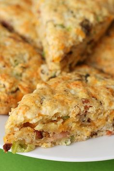 Bacon Cheddar Scones    Ingredients:  For the scones:  3 cups all-purpose flour  1 tbsp. baking powder  1 tsp. salt  1-2 tsp. ground black pepper (depending on your preference)  8 tbsp. cold unsalted butter, cut into small cubes  1½ cups grated cheddar cheese  4 green onions, thinly slices  10 slices bacon, cooked and chopped or crumbled into smal