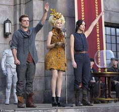 #CatchingFire new photo of Katniss and Peeta, #ComicCon panel details