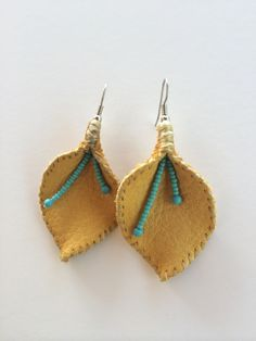 hand stitched leather and sinew earrings by twigsandbones