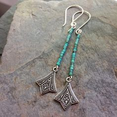 "51 Likes, 1 Comments - E. Seidel-Stone Crow Studios (@stonecrowstudios) on Instagram: ""The tiniest turquoise heishi beads and silver charms create these ""charming"" ;) long earrings!!…"""