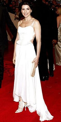 The Good Wife's star gives good smile too, glowing on the red carpet in her custom Narciso Rodriguez cut-out white gown, white strappy sandals and ivory clutch.