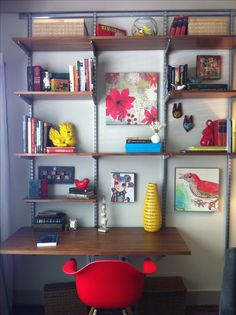Elfa shelving and desk brought from the old place and reconfigured. Modern plastic chair one of two from Overstock.