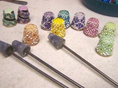 Thimbles out of the kiln ready to be cleaned.
