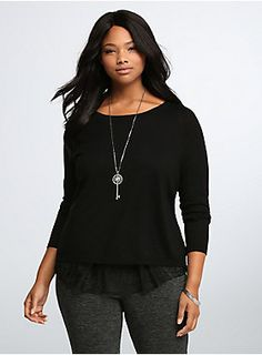 <p>Peekaboo! We see you (looking amazing). A sleek black knit pullover top (lightweight + so comfy = yes please) has racy lace…