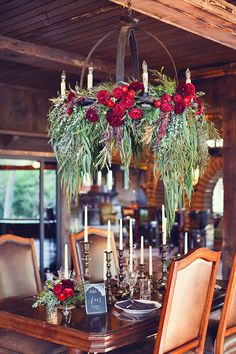 A floral and greenery chandelier | Brides.com