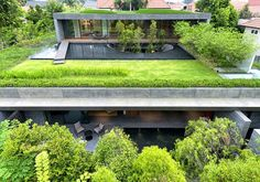 [twisted sifter] Completed earlier this year by architecture and design firm FARM, Wall House is an oasis in the heart of the concrete jungle. Located in the highly urbanized city-state of Singapore, the home is surrounded by lush greenery with trees throughout and multiple green roofs. -- See more pics & read more: http://twistedsifter.com/2013/08/wall-house-by-farm-singapore/