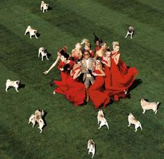2007. Valentino surrounded by models and pugs, by Jean Paul Goude for Harper's Bazaar. Valentino owns six pugs Molly, Milton, Monty, Margot, Maude and Maggie