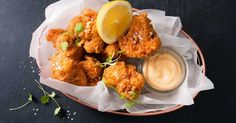 For the perfect finger food, try these crispy deep-fried cauliflower, dipped in a creamy sriracha chilli mayo.