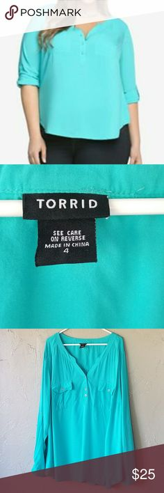 Torrid Teal Georgette Pull Over Blouse Your weekday morning rush just got that much easier. This gorgeous teal georgette blouse is easy to throw on (but so comfy it's hard to take off! tab sleeves, a Mandarin collar and double pockets lend desk-duty polish to the easy look. Teal aqua blouse roll button sleeves plus size Blouse. Size 4 same as 4x see size chartfor a better fit. Blue green color   torrid Tops Blouses