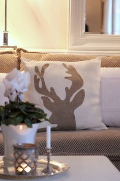 Reindeer silhouette pillow! Fun for to throw a little something a Blue would like in your decor. Oneand2.com