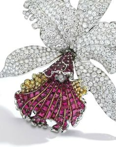 {Platinum, 18 Karat Gold, Ruby, Diamond and Colored Diamond Orchid Brooch, Marcus & Co. Estimate 45,000 — 65,000 USD. Lot sold 75,000 USD. Photo Sotheby's}