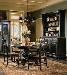 This is the look I am going for in my dining room - am repainting the chairs and table bottom black, leaving the tabletop natural wood finish, and then re-covering the chair seats