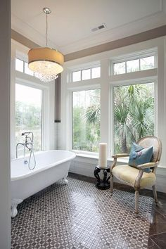 Breathtaking bathroom. The windows are fabulous. Open, airy & refreshing.