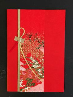 handmade greeting card ... one layer ... elegant look with just a strip of beautiful patterned paper, thin gold mat on one isde and a simple loop of misohige (Sp?) ...