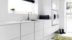 Snygg tvättstuga med smarta lösningar!