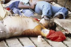 The Reverend Jim Jones' bloated body lies on the ground after it was hastily sewn together after his autopsy by officials on November 18, 1978 in Jonestown, Guyana.