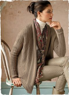 A downy-soft layer of Camel royal alpaca, knit in a profusion of tiny twists and chevron cables. Drapy shawl collar, drop shoulders and chunky ribbed trim.