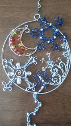Winter night snowflake sun catcher with hammered aluminum wire, beaded wire wrapped moon.