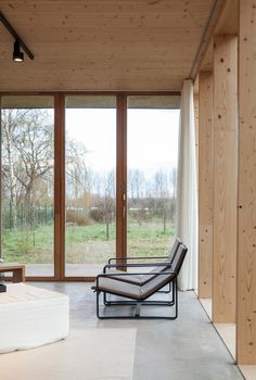 This holiday house is located in Belgium and was built using low cost materials (plywood, metal, concrete) and being inspired by Japan. Lots of windows, glass walls and folding doors connect the in…