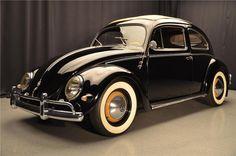 1957 VW Bug ragtop finished in Raven Black with tan interior and tan sliding rag. Vw Bus, Auto Volkswagen, Volkswagen Beetle Vintage, Peugeot, Carros Vw, Vw Cabrio, Kdf Wagen, Vw Classic, Vw Vintage