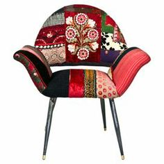 """Add a pop of color to your living room seating group with this handcrafted arm chair, featuring a midcentury-inspired silhouette and patchwork upholstery.  Product: ChairConstruction Material: Fabric, wood and ironColor: MultiFeatures: HandmadeDimensions: 37.5"""" H x 33.5"""" W x 29.6"""" D"""