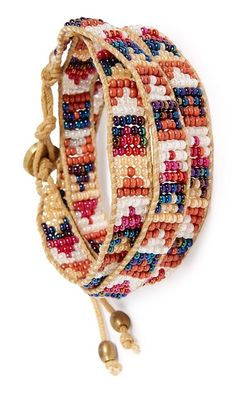Stacking beaded bracelets on the wrist for a fun and boho-inspired look.