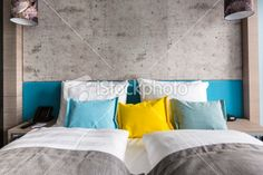 Modern Hotel Bedroom with colorful pillows.