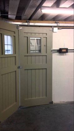 Round the corner garage door to avoid overhead clearance problem we were given the task of automating this large wooden side sliding garage door with the help of our friends at sommer uk we purpose made a longer than solutioingenieria Choice Image