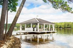 This waterfront retreat by Heather Garrett Interior Design features plenty of patios and spaces that make the most of living on beautiful Lake Gaston. Lake Dock, Boat Dock, Decoration Chic, Lakeside Living, Outdoor Living, Lakeside Beach, Outdoor Rooms, Deck Party, Lakefront Property