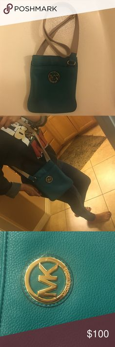 Michael Kors Teal Crossbody bag I love this is really cute and gives any outfit a pop of color I dont carry it enough to justify it. Authentic ofcourse. The lighting is not the best right now it is 9pm but the true color shows up on the 3rd pic Michael Kors Bags Crossbody Bags