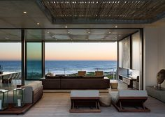 indoor/outdoor, glass wall transtition (Pearl Bay Residence by Gavin Maddock overlooks the ocean)