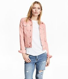 Light pink. Jacket in washed denim with metal buttons. Collar, buttons at front, chest pockets with flap and button, and welt side pockets. Buttons at cuffs