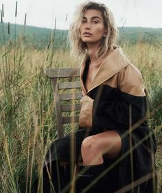 fashion editorial Hailey Baldwin looks lovely in blue for Vogue Australias October 2019 cover. Photographed by Lachlan Bailey, she wears a Burberry jacket with Cartier earrings and rings. Accompanying images show Hailey posing outdoors in new season