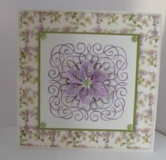 A stitched card with a ribbon flower in the centre, coloured to match.