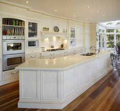 Kitchen benchtops sydney: white kitchen with a very large curved benchtop. Kitchen Benchtops, White Kitchen Cabinets, Kitchen Countertops, Kitchen Colors, Kitchen Decor, Kitchen Design, Kitchen Ideas, Kitchen Tops, Bathroom Showrooms