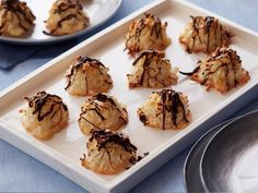 Chocolate-Coconut Macaroons : Grace your holiday dessert spread with these elegant coconut macaroons. Unsweetened coconut flakes provide their signature texture, and a drizzle of melted semisweet chocolate adds a festive touch. Passover Desserts, Passover Recipes, Passover Food, Healthy Desserts, Jewish Recipes, Healthy Eats, Healthy Recipes, Baking Recipes, Cookie Recipes