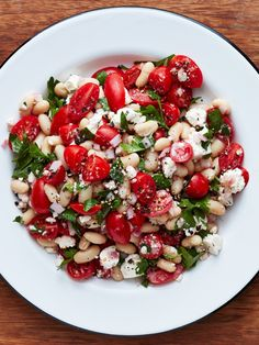It's extra juicy, salty, fresh, and satisfying. This recipe for tomato and feta cheese salad is great for a summer meal. This healthy vegetarian dish uses white beans as a base and is combined with juicy tomatoes while topped with parsely, oregano and feta cheese.