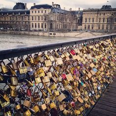 Lovers' padlocks on the bridge...keys tossed in the seine au revoir. I want to do this!!