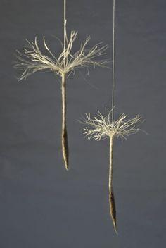 Anu Völp felt sculptures: mobile - look like dandelions - detail