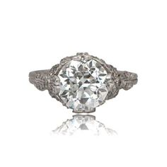 A Beautiful and Intricate Edwardian Style Engagement Ring set in Platinum.  The Diamond is an Old European Cut and is approximately 3.15ct.