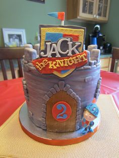 """Mike The Knight cake, double 8"""" covered in MMF with gum paste accents & figures."""