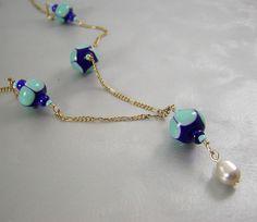 Vintage Blue Lampwork Bead Necklace. $20.00, via Etsy.