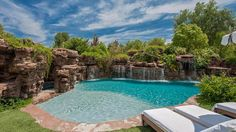 Pool with waterfalls, beach entry, & grotto is a showstopper. Denise Richards merged two pools to create her lagoon-style pool at her Hidden Hills, LA home. ~ latimes.com