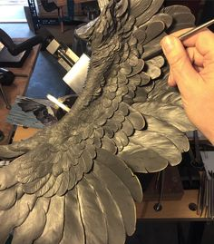 Slowly getting nearer the end of feathering the Griffin's wings. Looking forward to working on the mane and body soon - I need a change, but I have to finish this wing first 😏 Wing Anatomy, Javier Marin, How To Make Clay, Feather Crafts, Wooden Bird, Carving Designs, Bird Sculpture, Clay Design, Scores