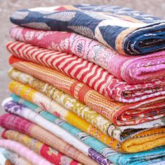 Beautiful Kantha Quilts! Blankets made from upcycled cotton sari's The purchase of one supports a survivor of Kolkata's red light district. Yobel Market
